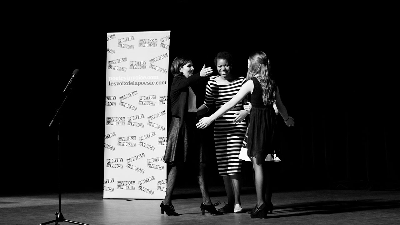 In the English Stream, Olivia Perry wins, Kiera Sandrock places second, and Ayo Akinfenwa wins third prize. Johanne Blais joins the group hug this time.