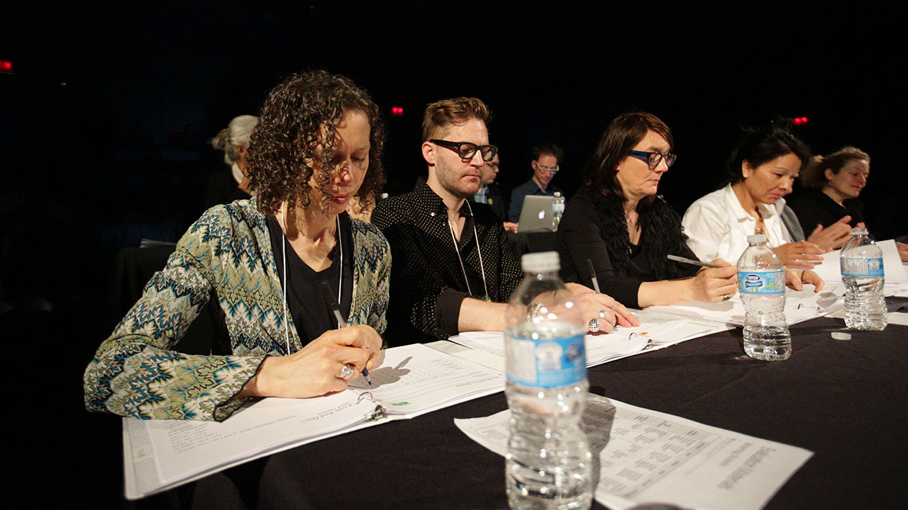 The judges review their score sheets. (l to r: Stephanie Bolster, Jeramy Dodds, Sina Queyras, Rita Mestokosho, and Jeanne Painchaud)