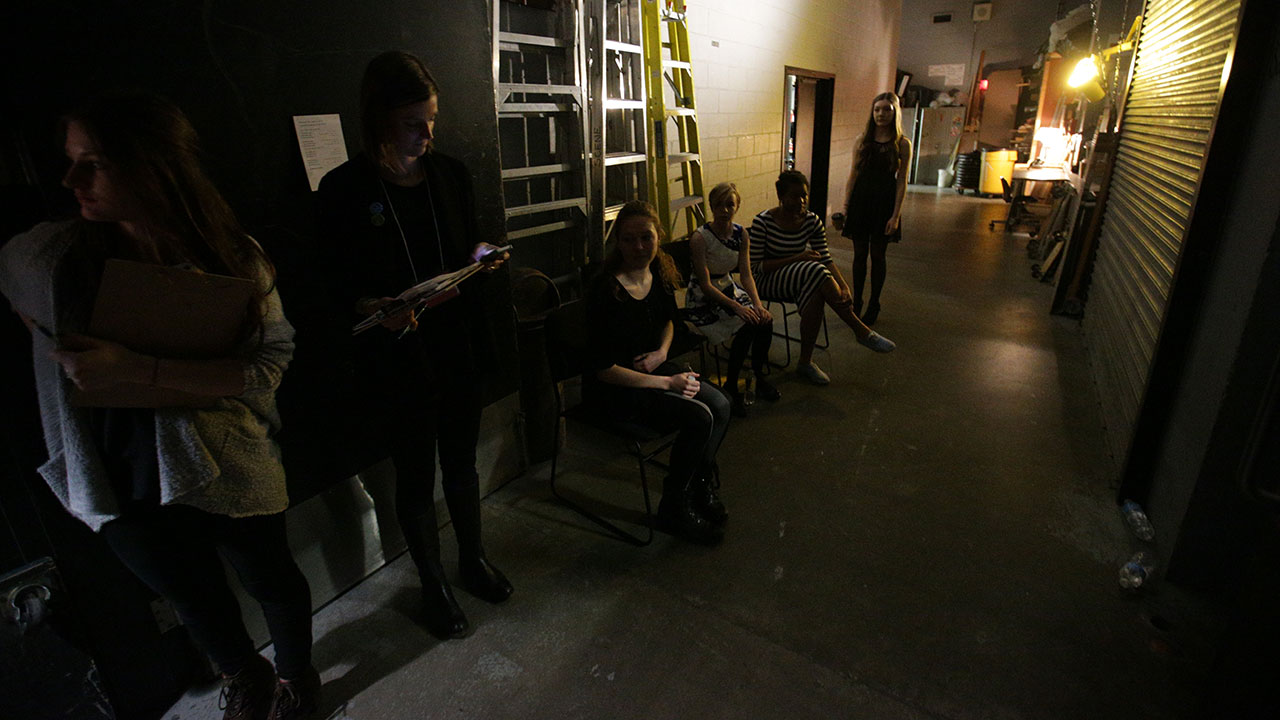 The finalists wait backstage for the house to close.