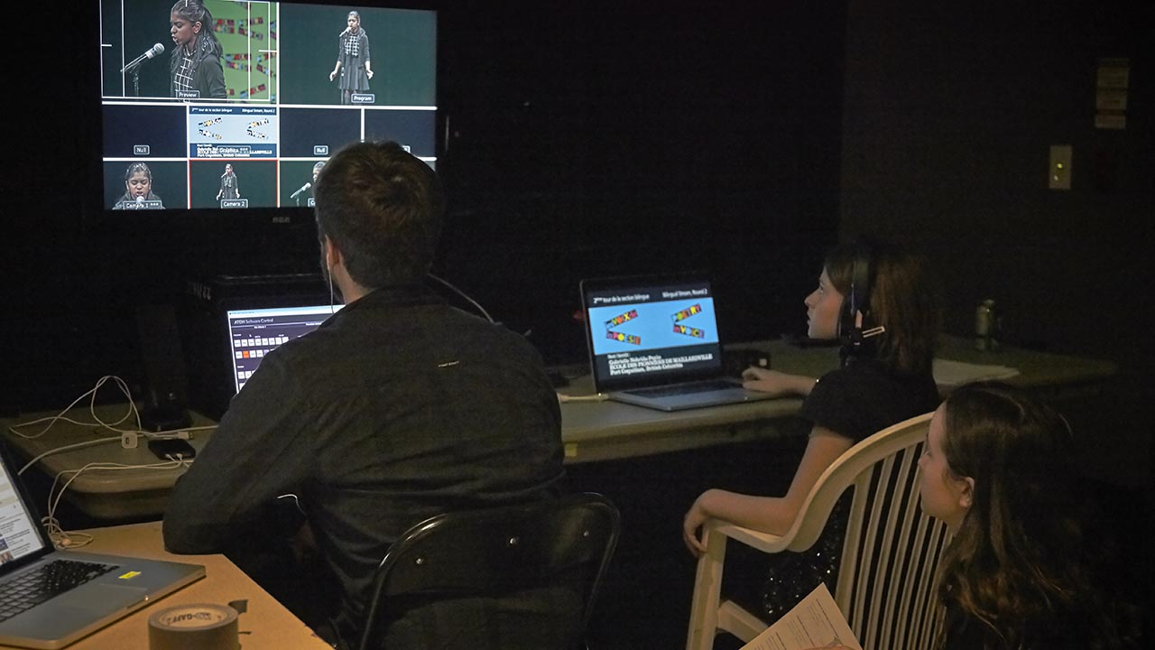 The livestream team prepares to broadcast the show.