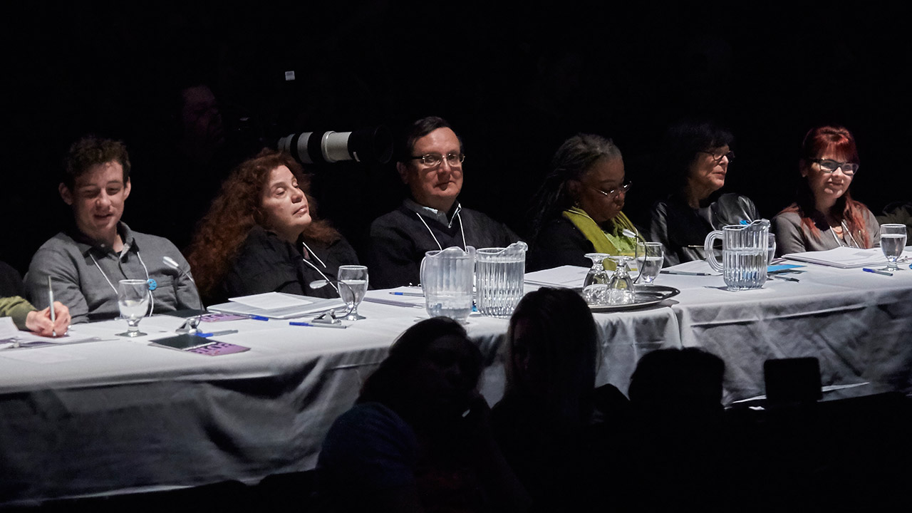 The judges are ready. (l to r: Mathew Henderson, Anne Michaels, Daniel David Moses, Marie-Célie Agnant, Denise Desautels, Sonia Lamontagne)