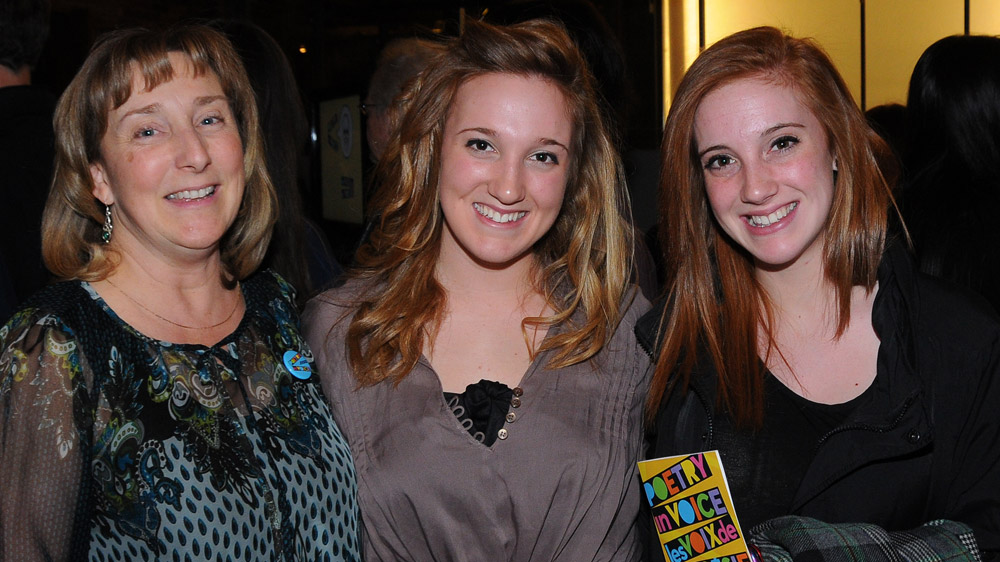 Poetry In Voice 2011 finalist Brogan Carruthers (centre) poses with supporters before the competition.