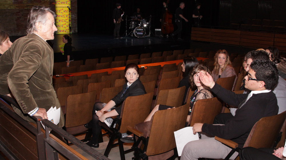 Tessa Griffin and Scott Griffin (far left) talk with Poetry In Voice 2011 finalists before the competition.