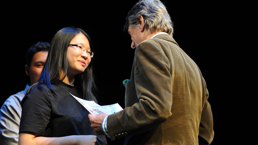 Founder Scott Griffin awards second-place winner Anna Jiang her certificate of participation and her $1,000 in prize money.