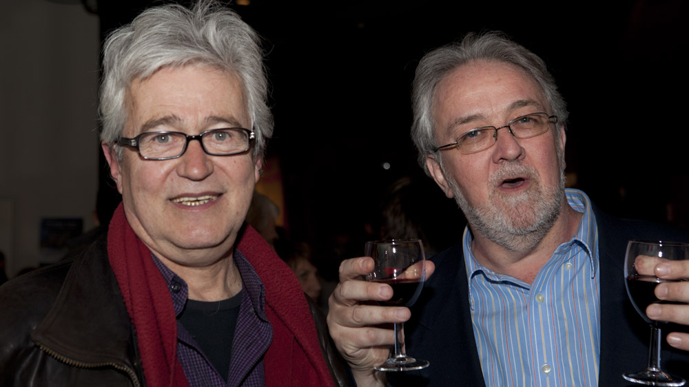Pierre Nepveu and MC Guy Marchamps raise a glass to poetry.