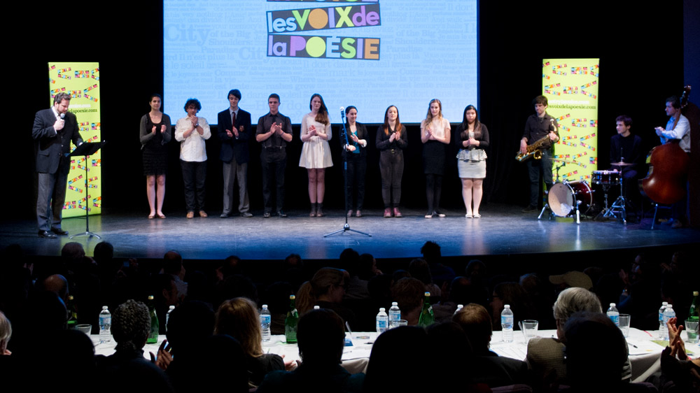 The nine finalists joined Albert Schultz on stage before the competition. (L. to r.) Liana Cusmano, Alexander Gagliano, Jeff Hunt, Josh Cape, Mary Jane Egan, Sidney Gilchrist, Sadie Anne Hirschfield, Eve Mangin, and Daniela Galdamez.
