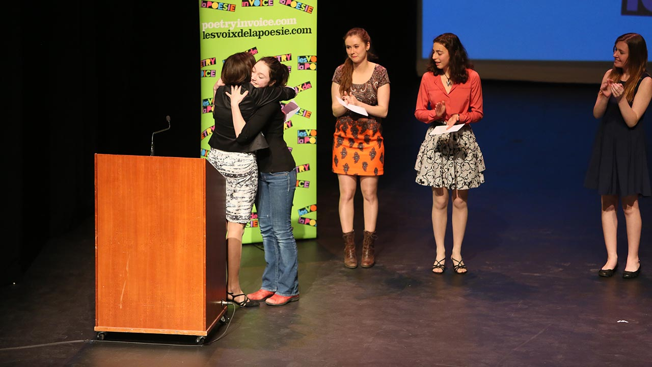 Kelsi James from Dr. Charles Best Secondary School is the 2014 National Bilingual Champion. Here, she is being congratulated by Johanne Blais as Marianne Verville, Andrea Rodriguez-Marin, and Madina Sutton look on.